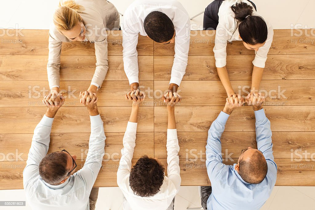 Team of business people joining hands stock photo