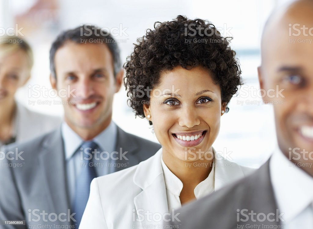 Team of business people standing in a row royalty-free stock photo