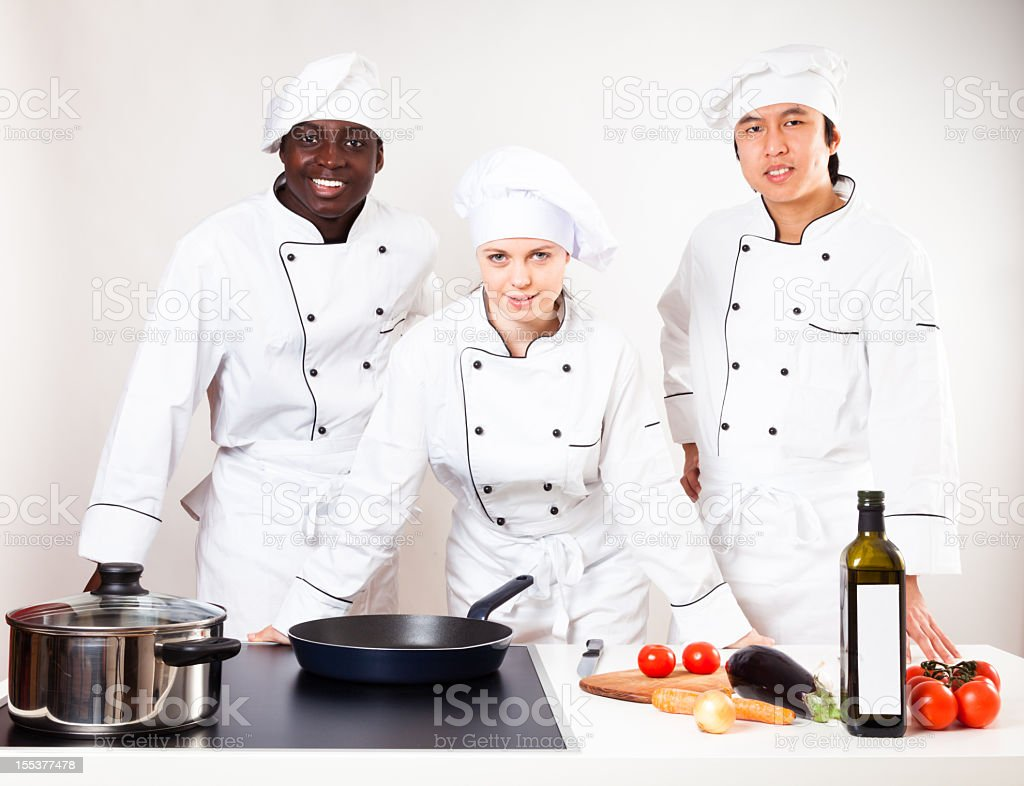 team of chefs in their kitchen stock photo