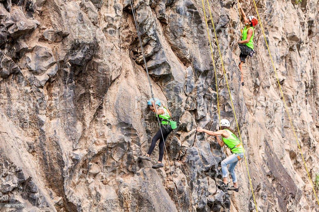 Basalt Challenge Of Tungurahua, Team Of Climbers Climbing A Rock Wall...
