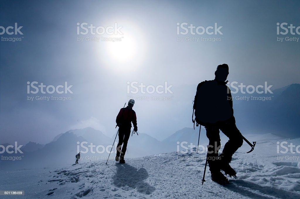Team of climbers on the mountain pass stock photo