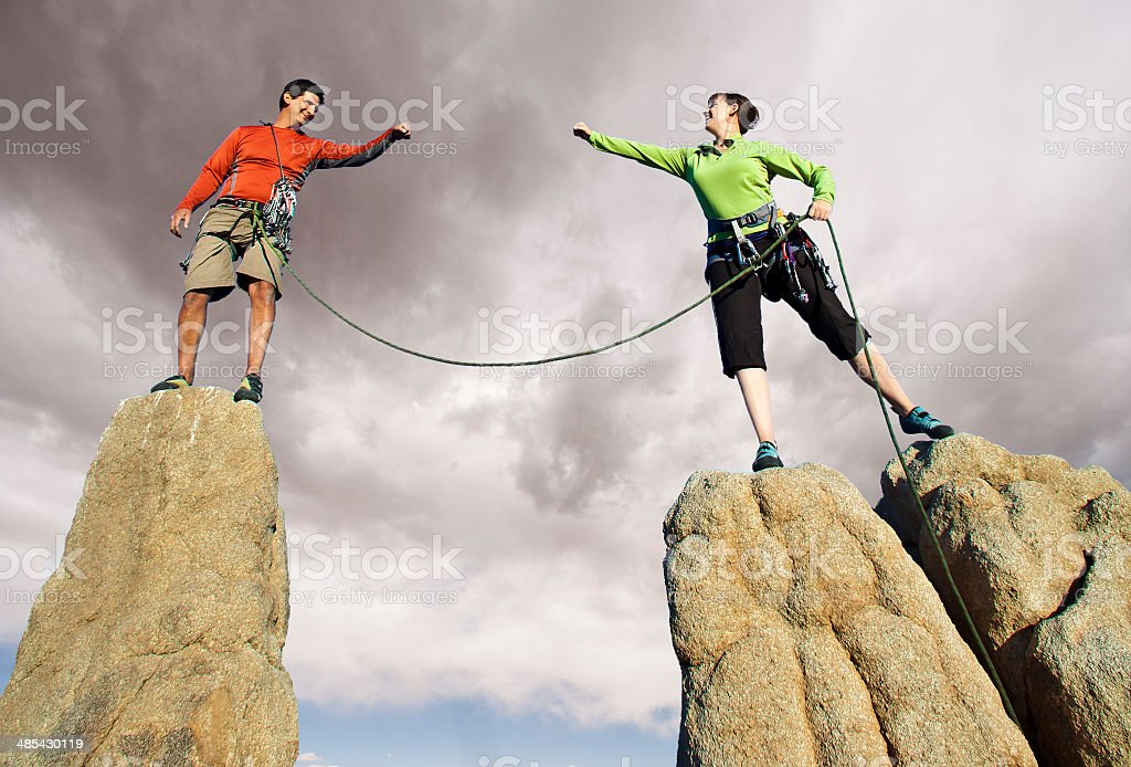 Team of climbers on the summit. stock photo
