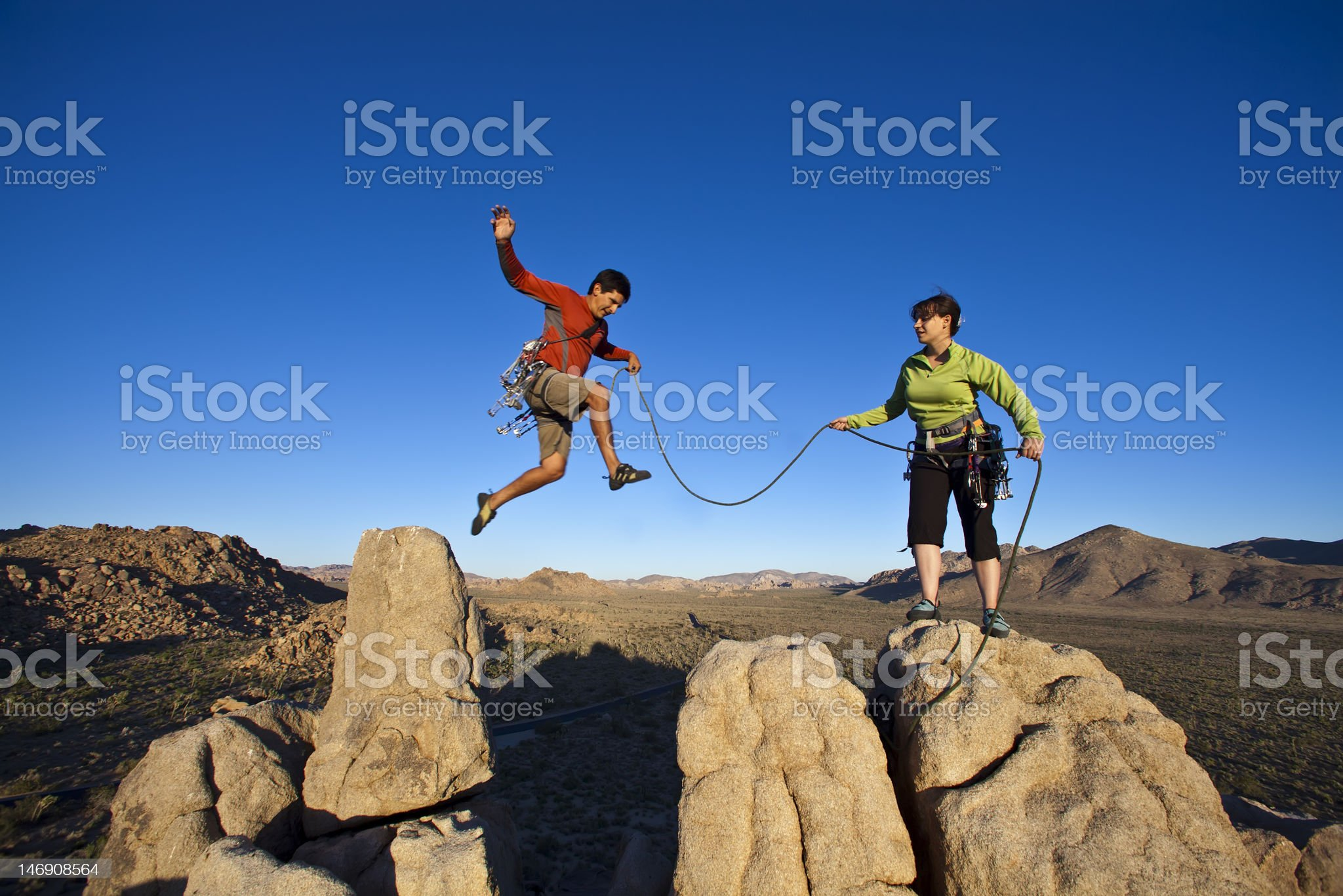 Team of climbers on the summit with ropes royalty-free stock photo