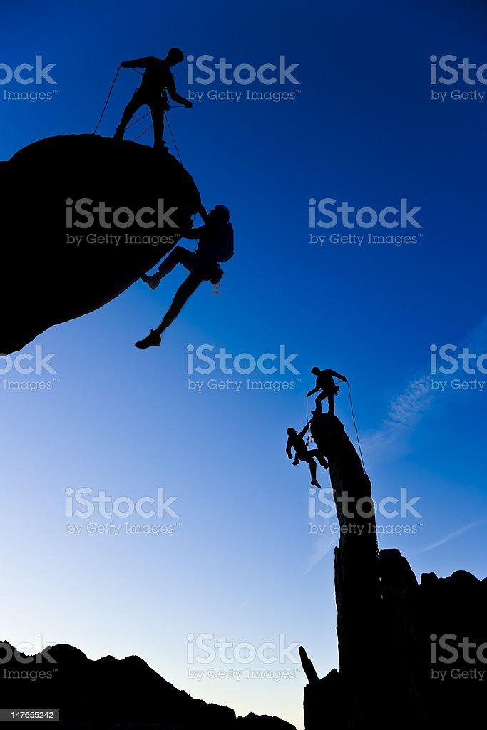 Team of climbers reaching the summit. royalty-free stock photo
