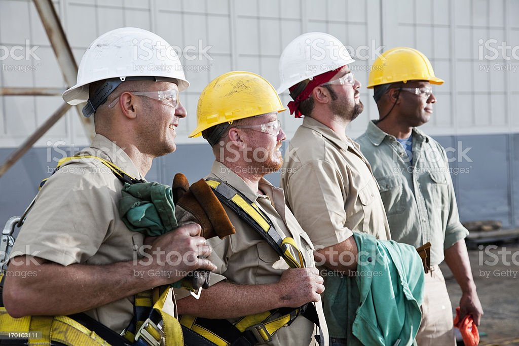 Team of construction workers with harnesses stock photo