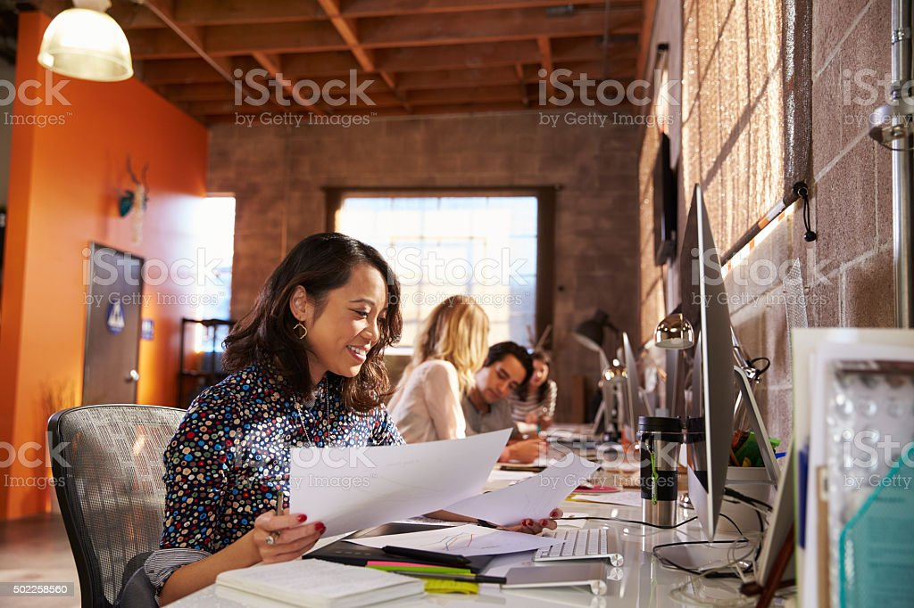Team Of Designers Working At Desks In Modern Office stock photo