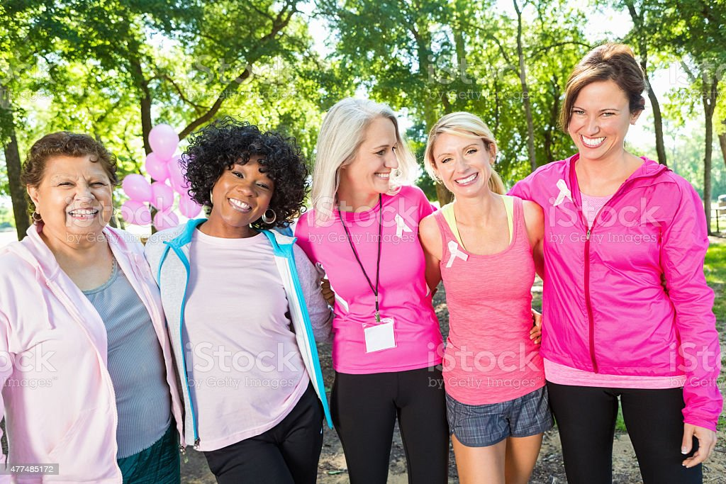 Team of diverse breast cancer survivors at marathon or race stock photo