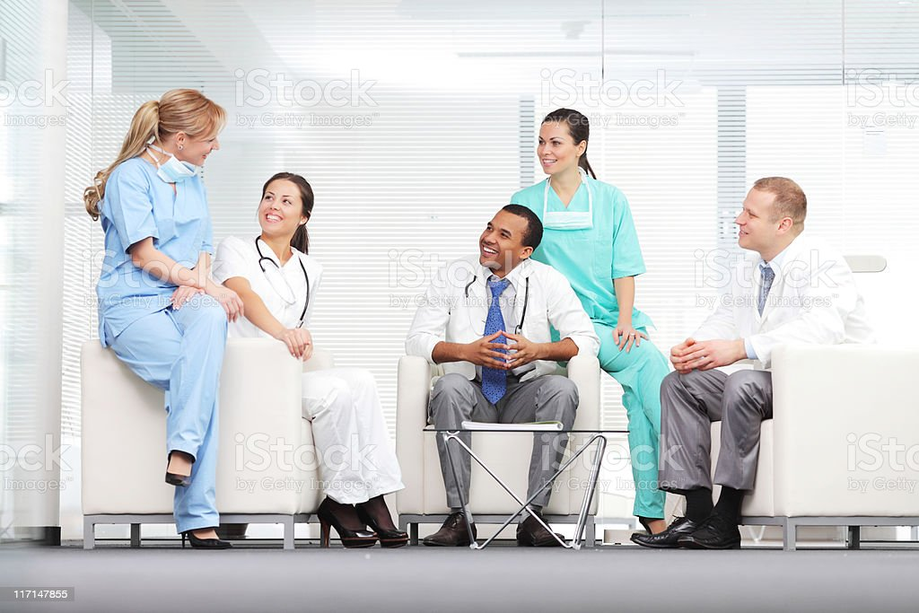 Team of doctors discussing in hospital. royalty-free stock photo