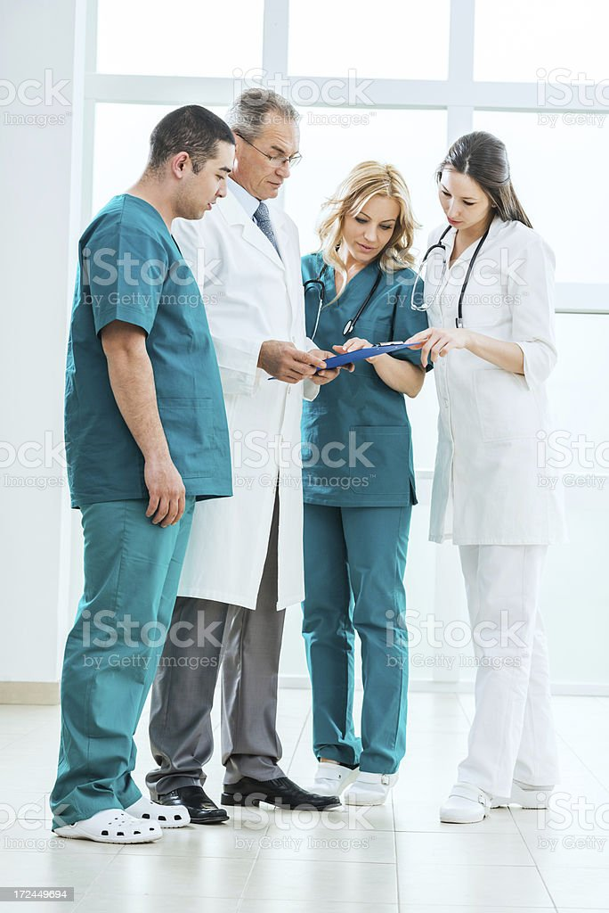 Team of doctors looking at medical chart. royalty-free stock photo