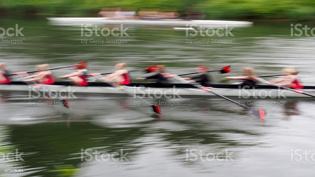 Team of Eight Rowing Boat, Motion Blur stock photo