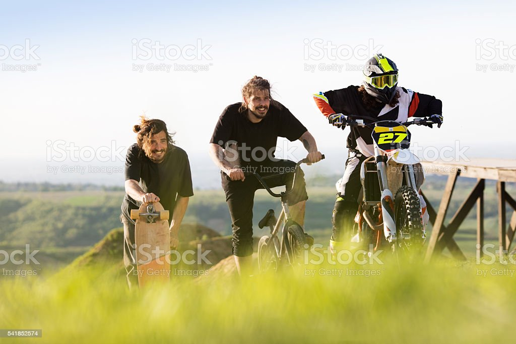 Team of extreme sports men preparing for race in nature. stock photo