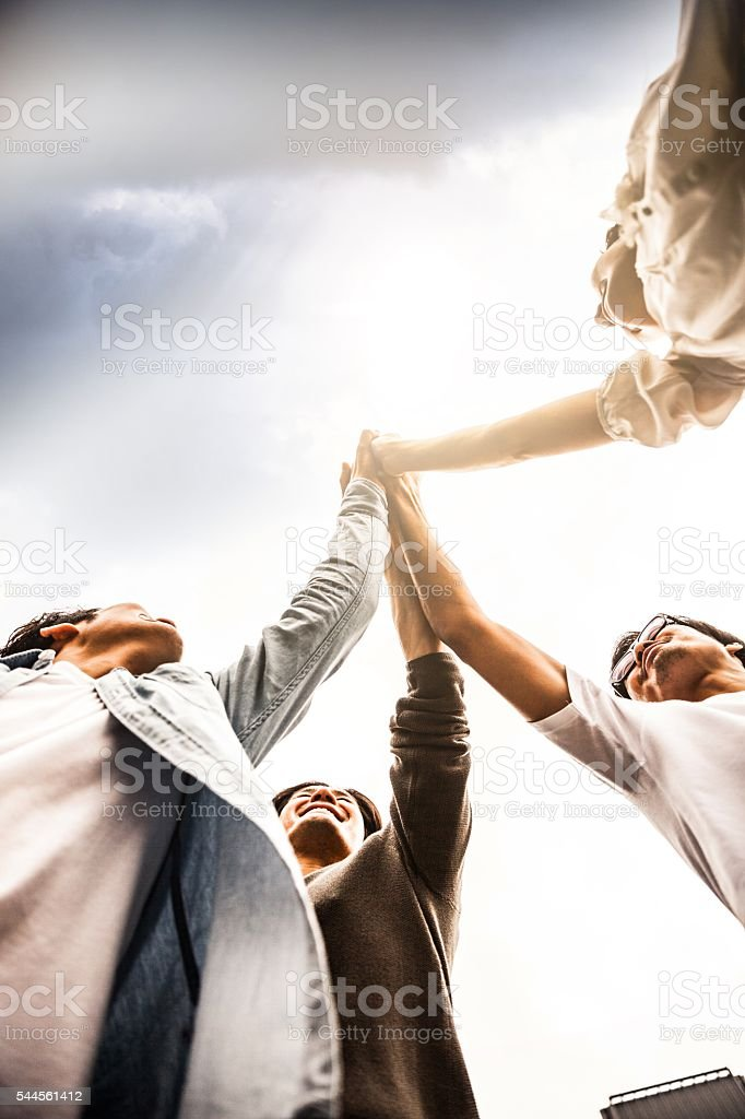 Team of friends cooperating together in Japan stock photo