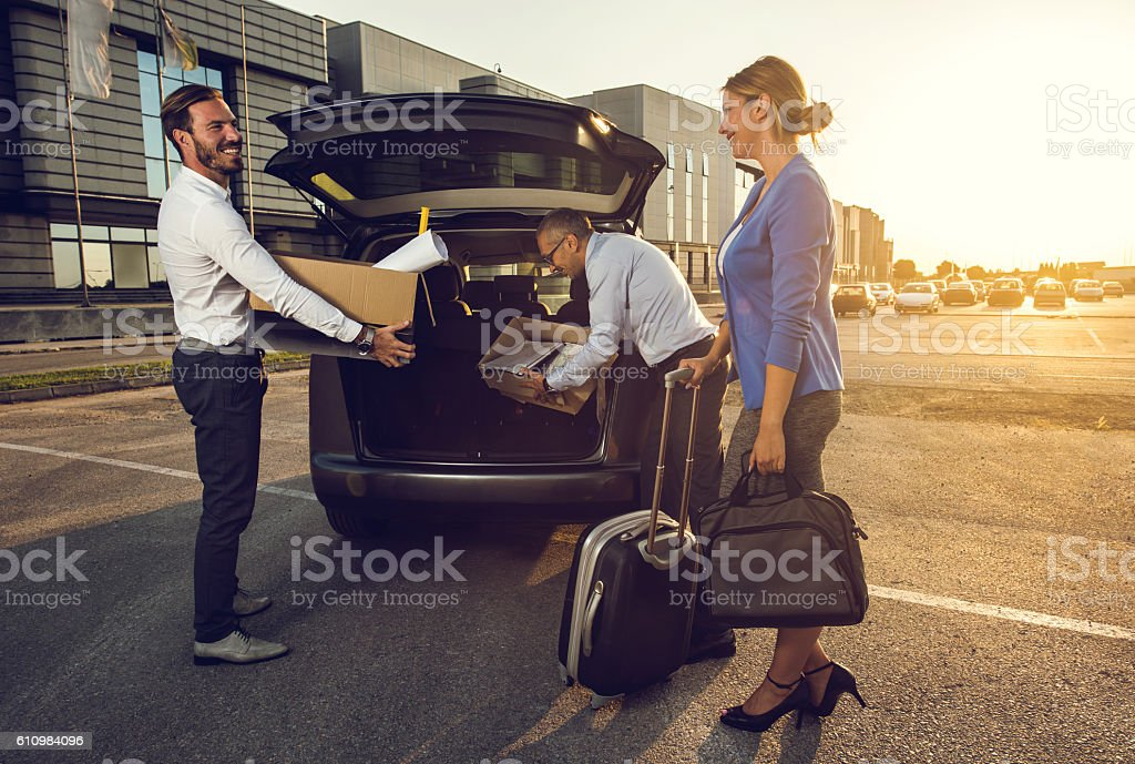 Team of happy business people packing for a travel. stock photo