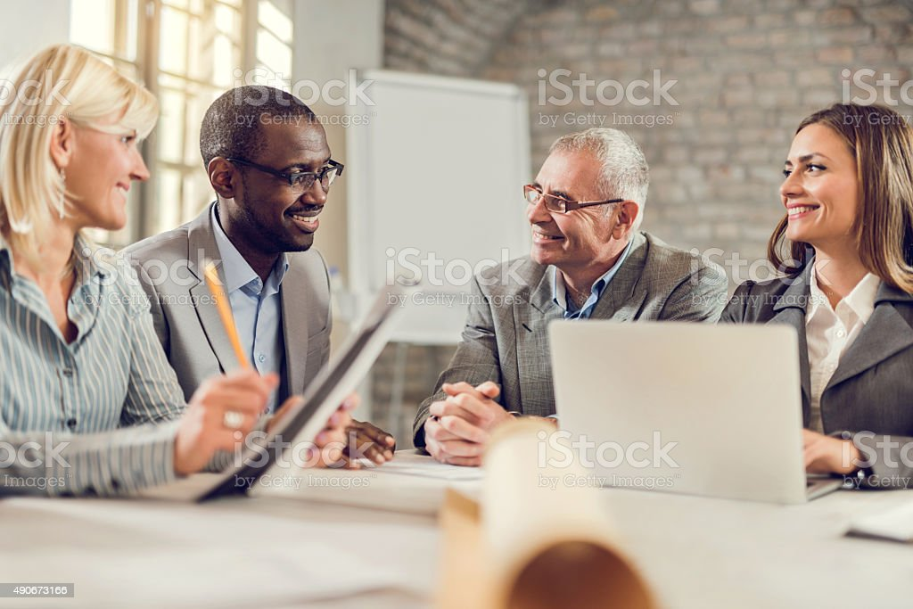Team of happy business people talking on a meeting. stock photo