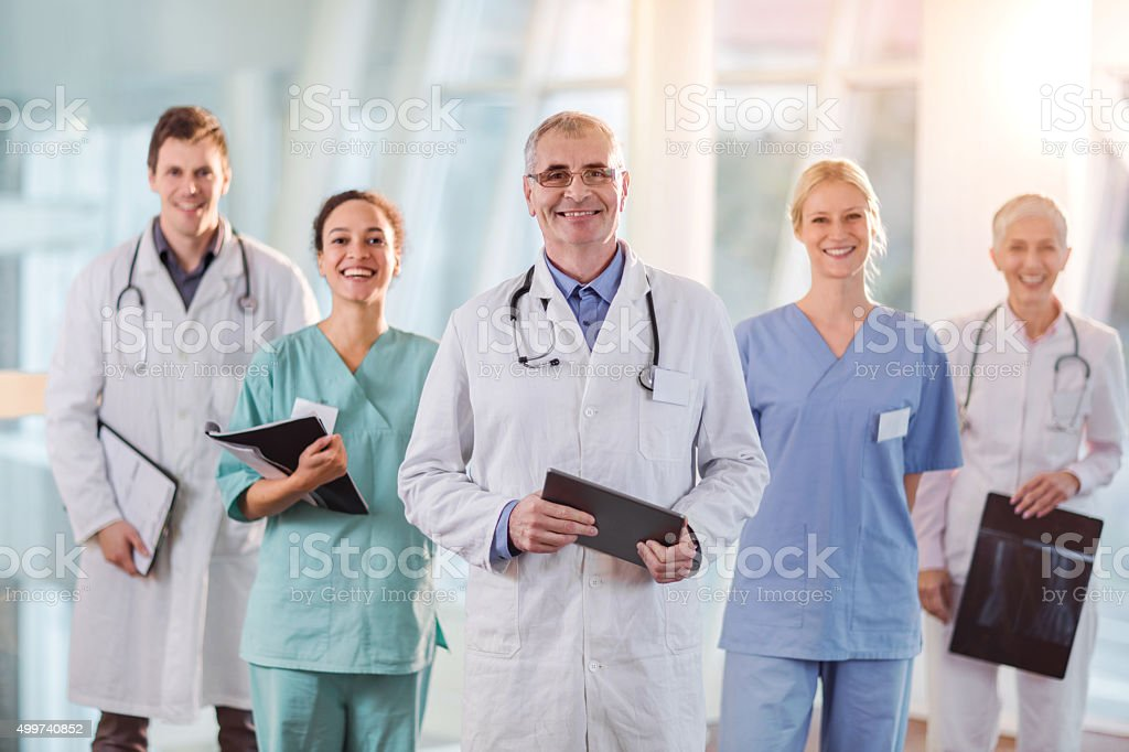 Team of happy medical workers in the hospital. stock photo