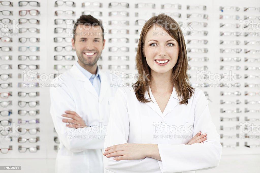 Team of happy opticians optometrists stock photo
