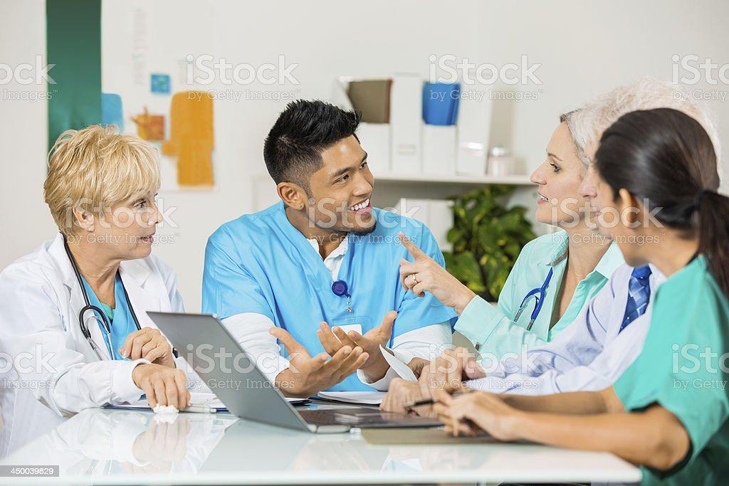 Team of hospital doctors and nurses having staff meeting royalty-free stock photo