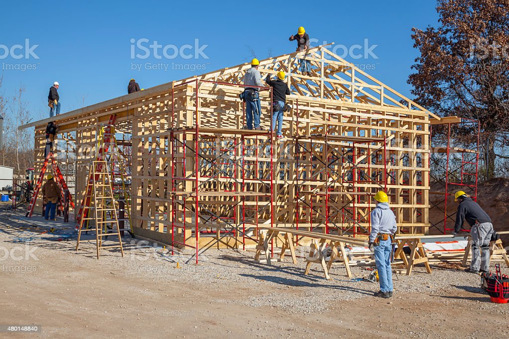 Team Of Man Framing a Building stock photo