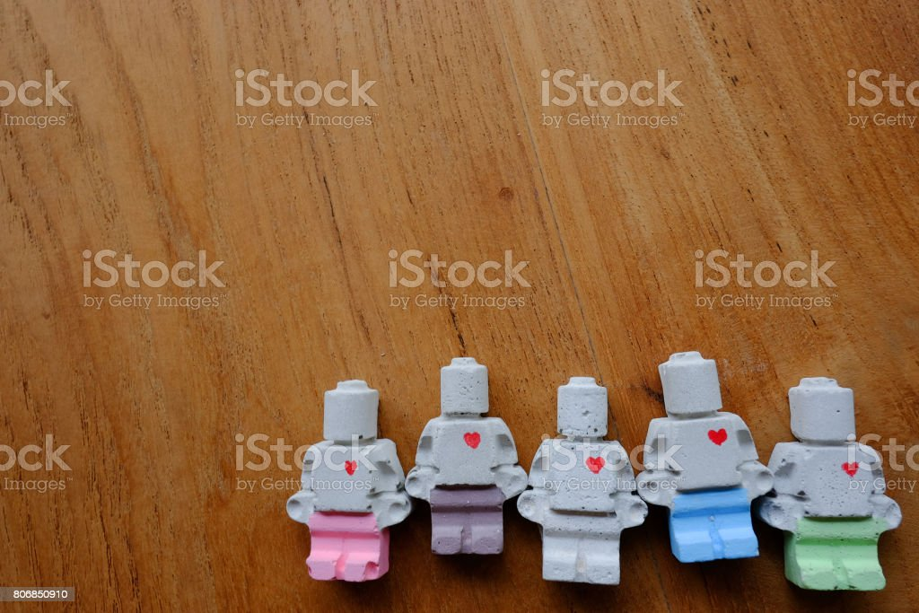Team of miniature clay doll on the bottom right of image stock photo