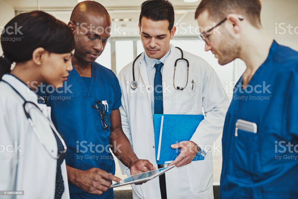 Team of multiracial doctors at hospital stock photo