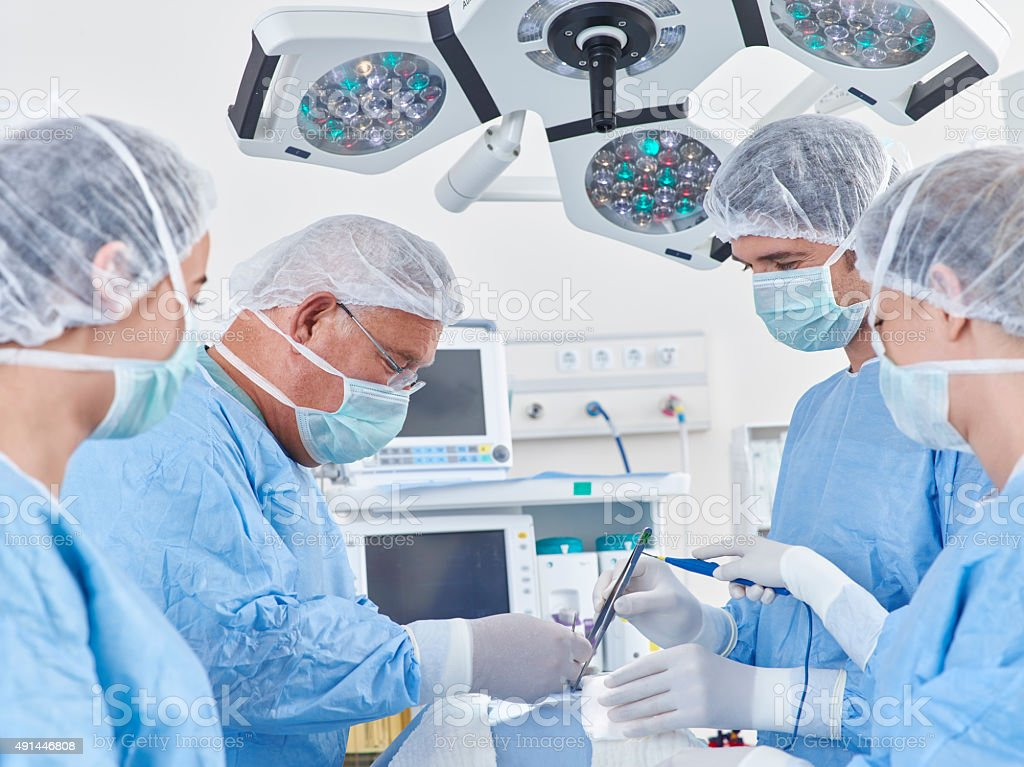 Team of nurses and surgeons in surgery stock photo