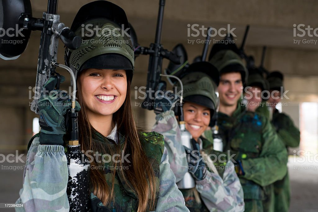 Team of paintball players posing with their paintball guns stock photo