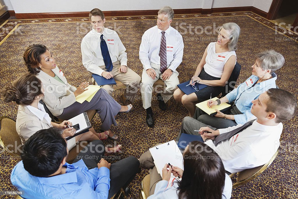 Team of people meeting together for business, counseling, or support royalty-free stock photo