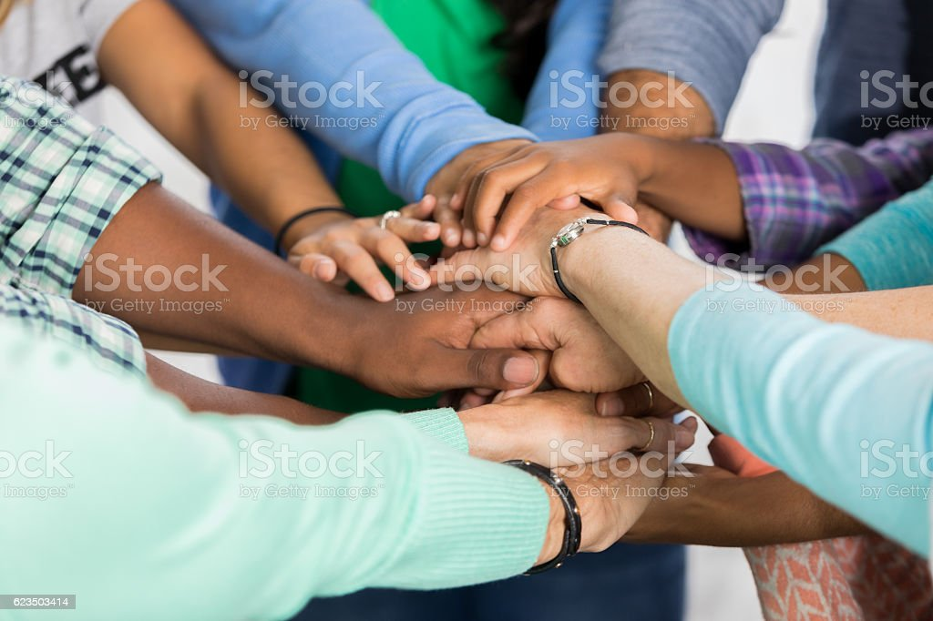 Team of people with hands together stock photo