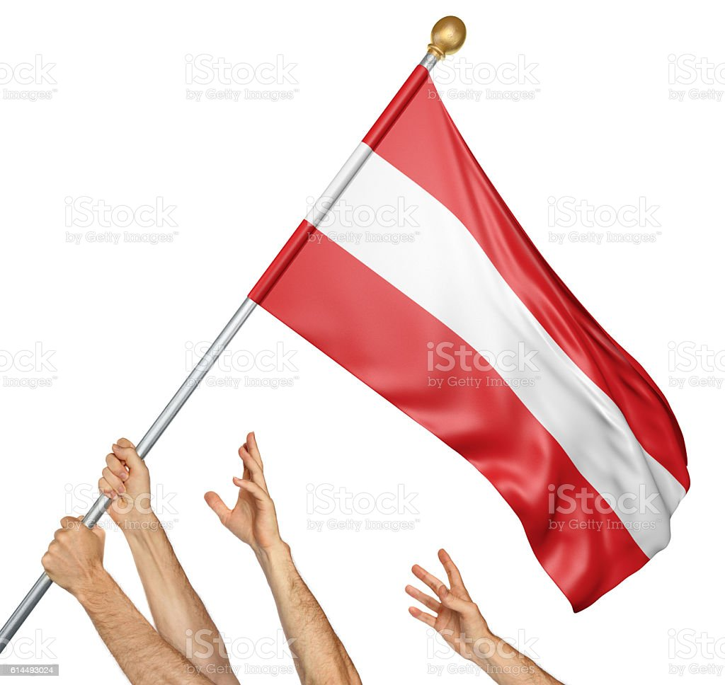 Team of peoples hands raising the Austria national flag stock photo