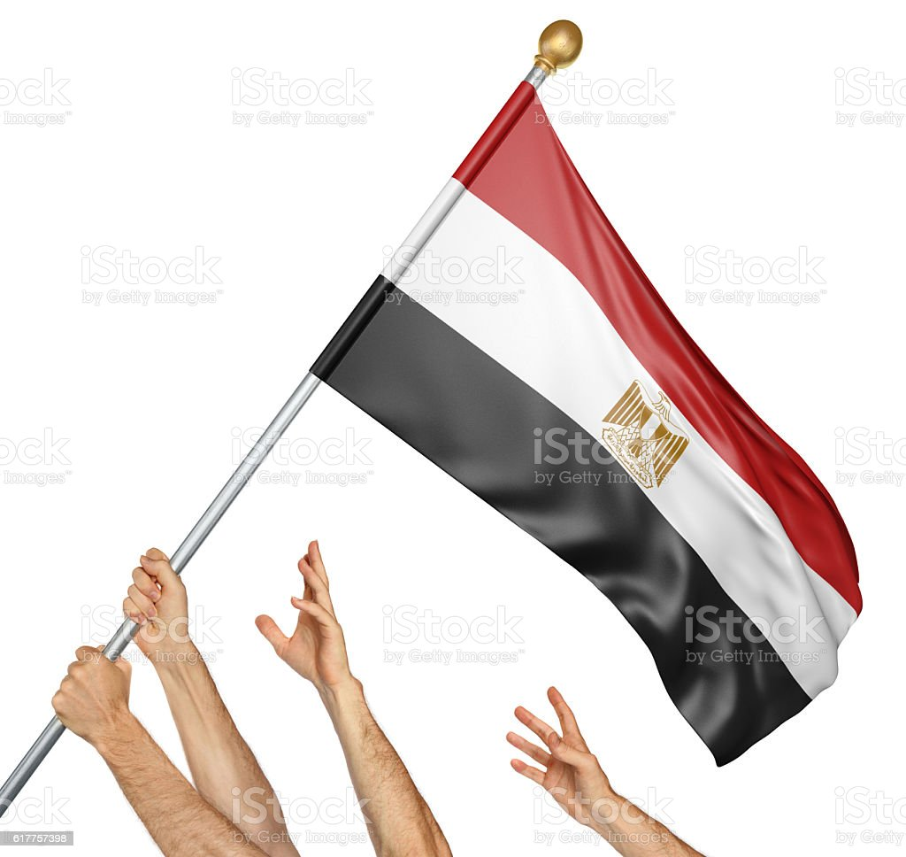 Team of peoples hands raising the Egypt national flag stock photo