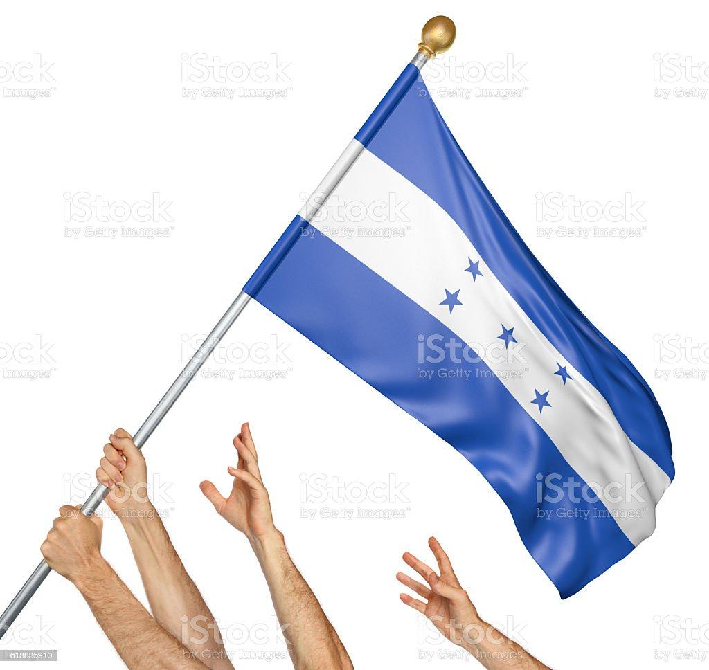Team of peoples hands raising the Honduras national flag stock photo