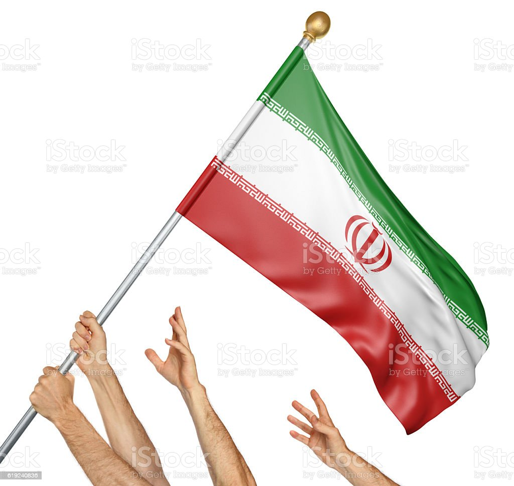 Team of peoples hands raising the Iran national flag stock photo