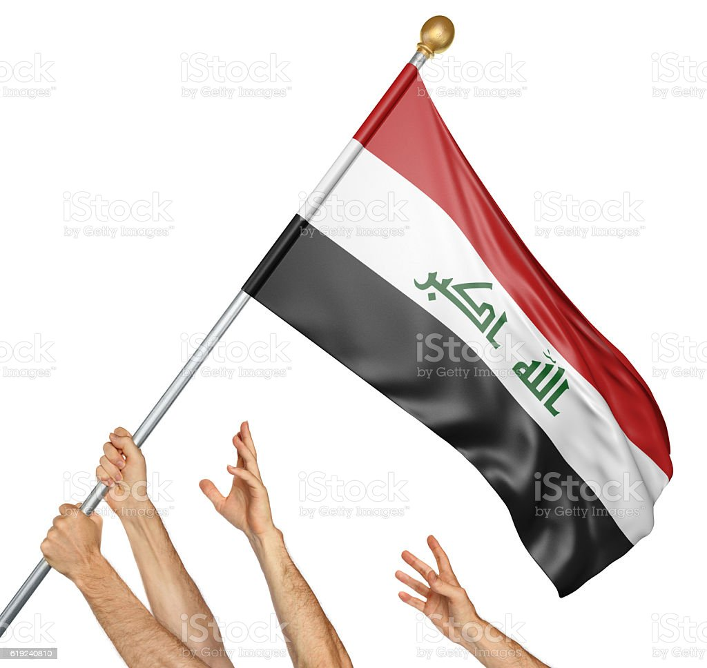 Team of peoples hands raising the Iraq national flag stock photo