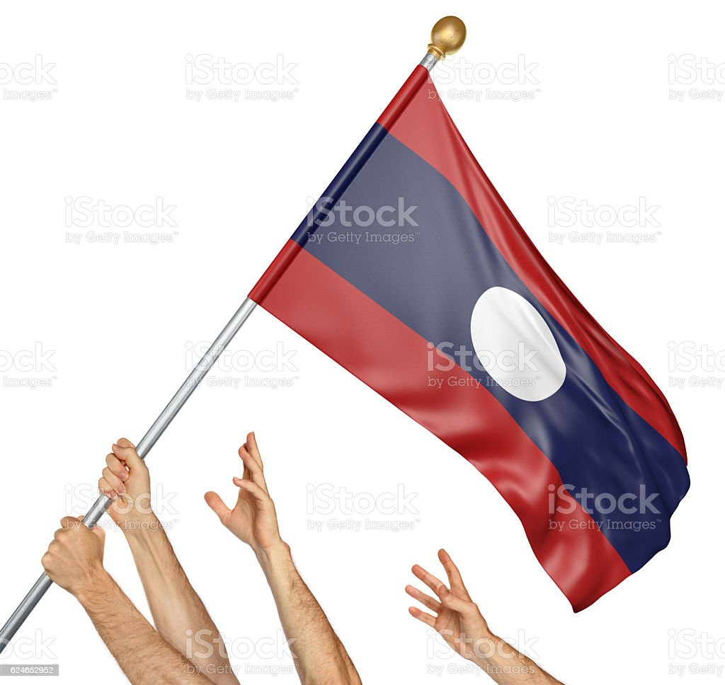 Team of peoples hands raising the Laos national flag stock photo