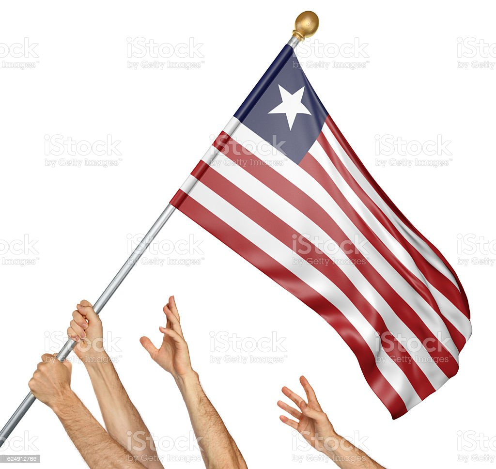 Team of peoples hands raising the Liberia national flag stock photo