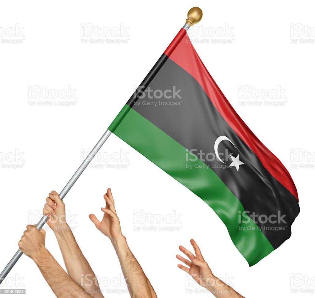 Team of peoples hands raising the Libya national flag stock photo