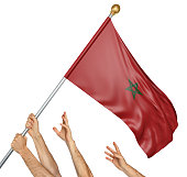 Team of peoples hands raising the Morocco national flag