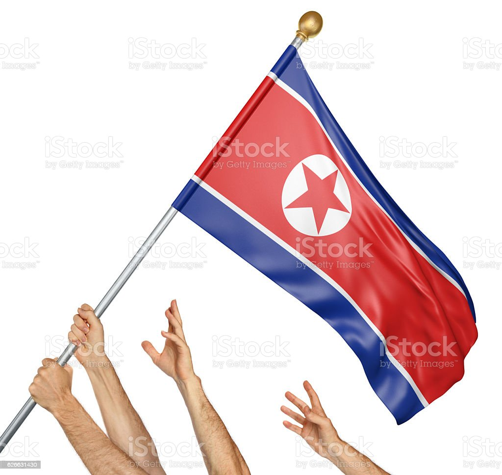 Team of peoples hands raising the North Korea national flag stock photo