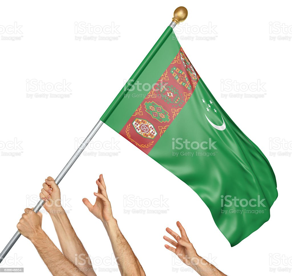 Team of peoples hands raising the Turkmenistan national flag stock photo
