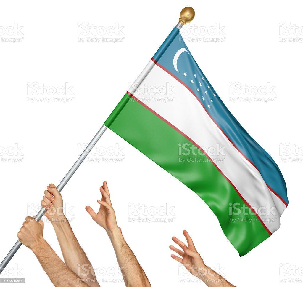 Team of peoples hands raising the Uzbekistan national flag stock photo