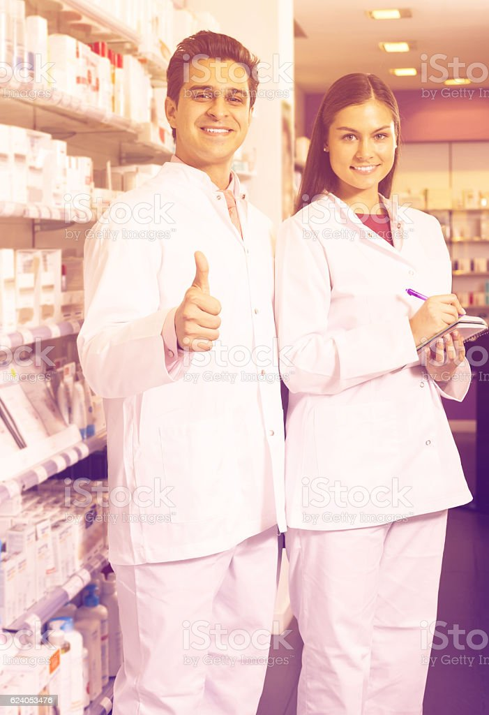 team of pharmaceutist and technician working in chemist shop stock photo