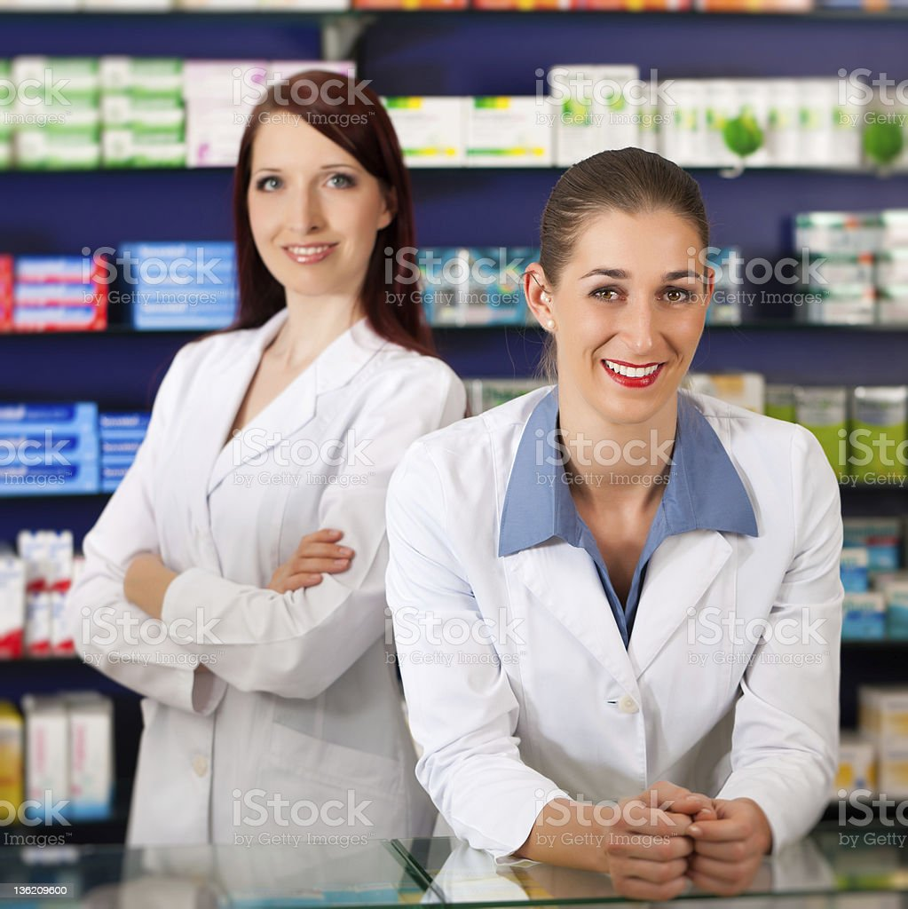 Team of pharmacists in pharmacy royalty-free stock photo