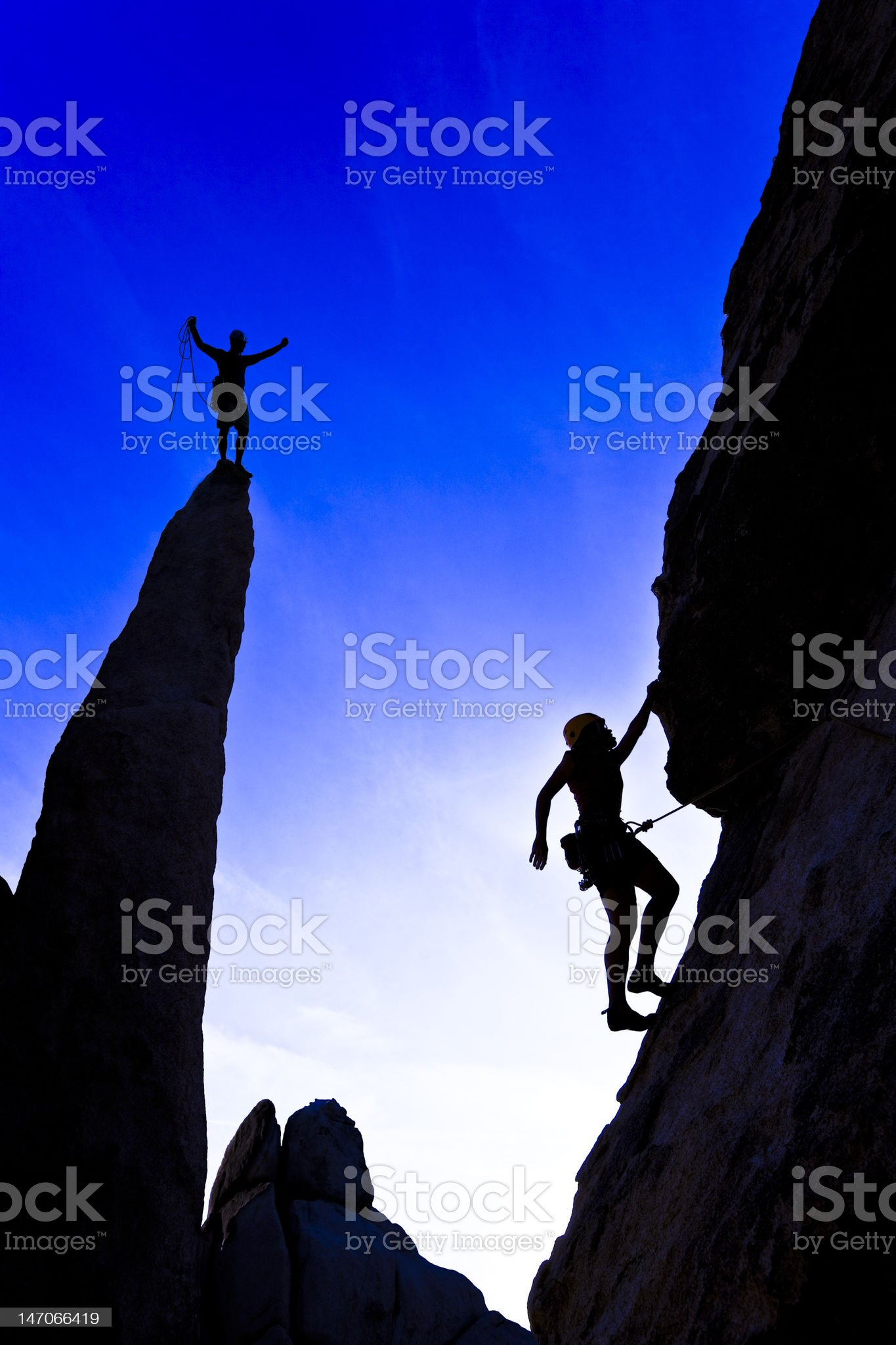 Team of rock climbers reaching the summit. royalty-free stock photo
