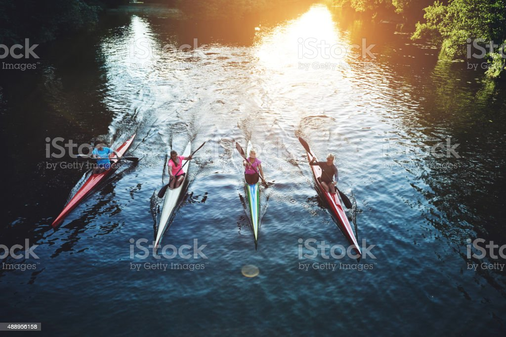 Team of rowing people stock photo