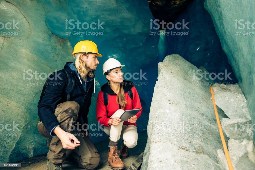 Team of Scientists Examining a Glacier stock photo