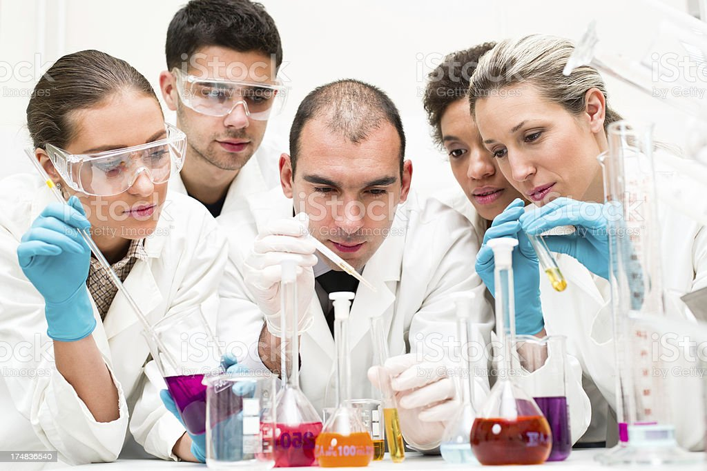 Team of scientists in a laboratory royalty-free stock photo