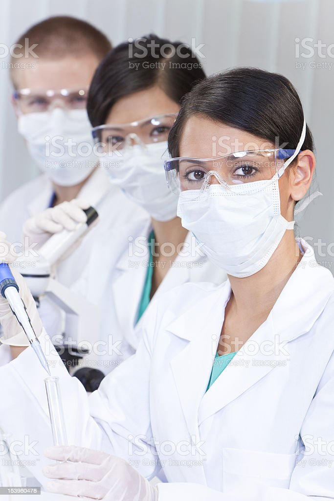 Team of Scientists With Test Tubes In Laboratory royalty-free stock photo