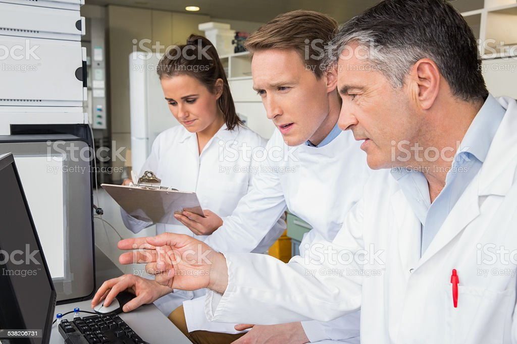 Team of scientists working together stock photo