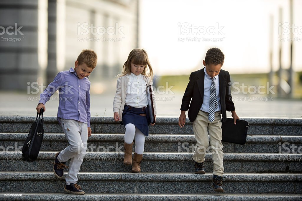 Team of small business people moving down the stairs. stock photo