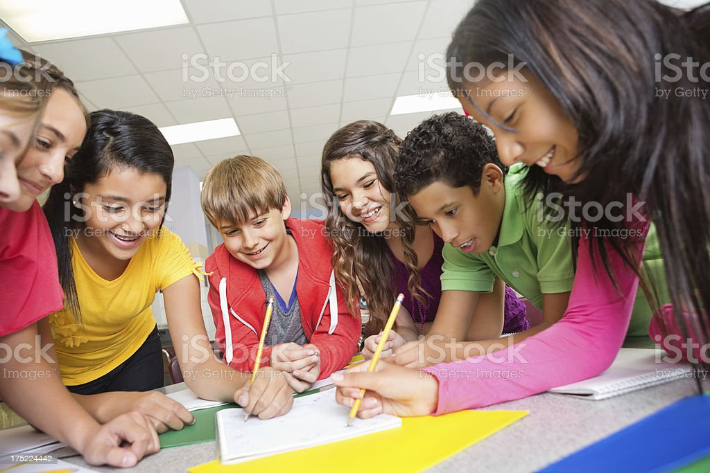 Team of students working on project together at school stock photo